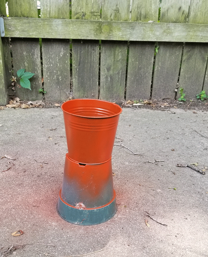 The planter pot spray painted with the Paprika Rustoleum paint.