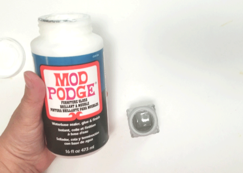 Using Mod Podge to seal the chalk paint on the glass