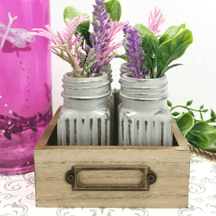 Chalk painted glass vases made from Dollar Tree salt and pepper shakers.