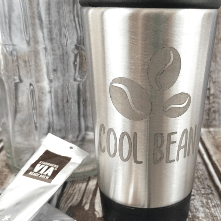 Finished coffee travel mug with etched metal design