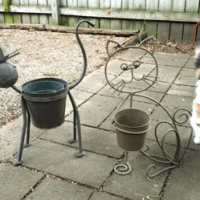 Paint for metal crafts will spruce up these drab outdoor cat planters