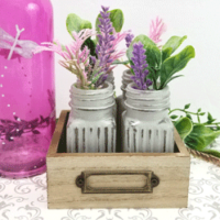 Cute mini vases made from glass salt and pepper shakers and chalky paint.
