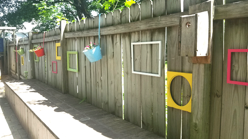 Finished fence with colorful frames from west to east.