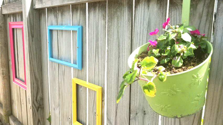 The fence with three frames and one planter.