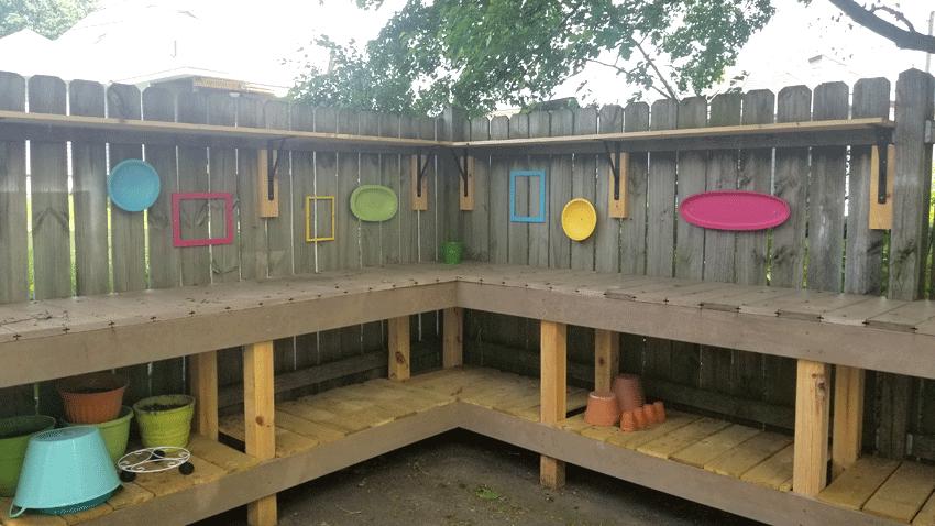 Finished fence decor above the potting bench