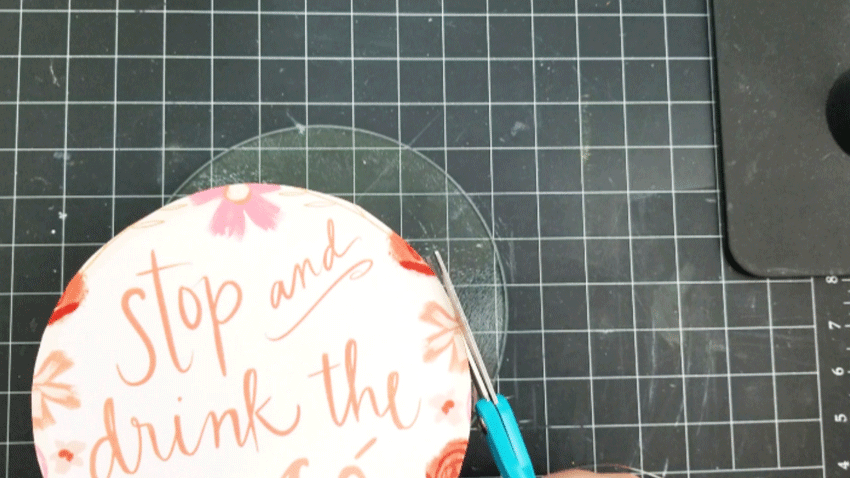Fitting the cut calendar page onto the glass cutting board and trimming where needed