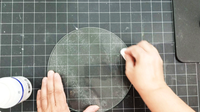 Using a cotton ball to remove sticky parts.