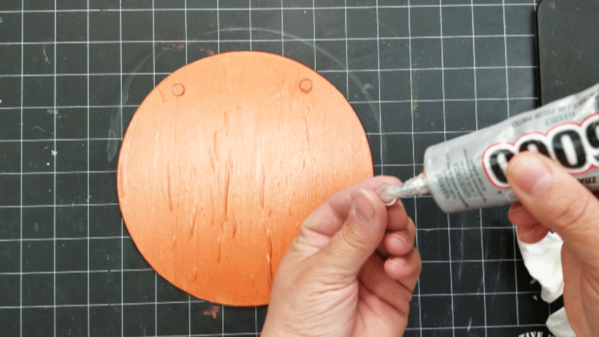 Gluing the gripper feet back onto the cutting board with E6000.