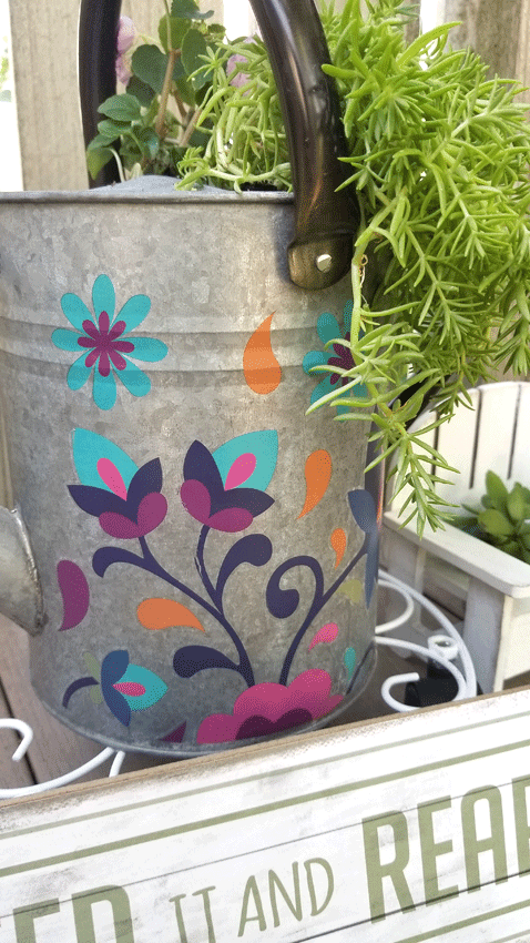 A close up phot of the planted DIY Metal Garden Art project with Dixie Belle Transfers