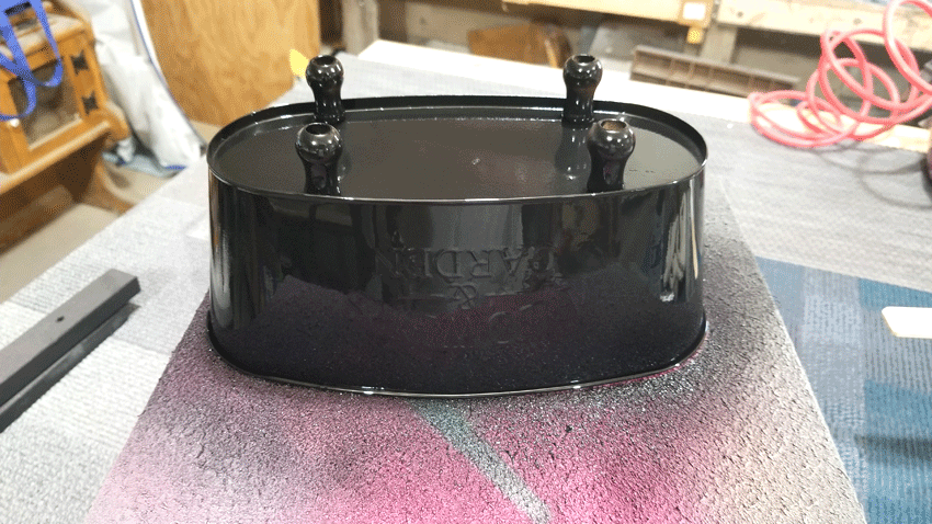 Flower container painted with black spray paint and primer.