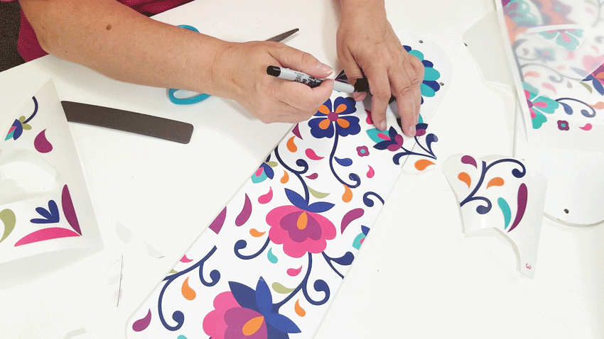 Adding a small grouping of flowers to fill in a blank area on the fan blade.