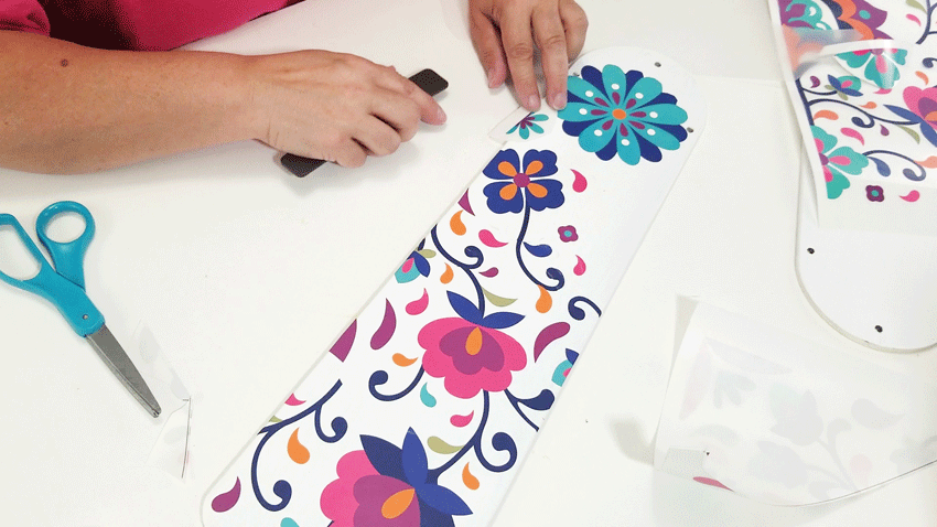 Adding a small flower to fill in the empty spaces in the design.