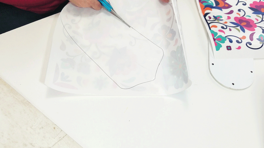 Cutting out the traced design from the transfer for the fan blade.