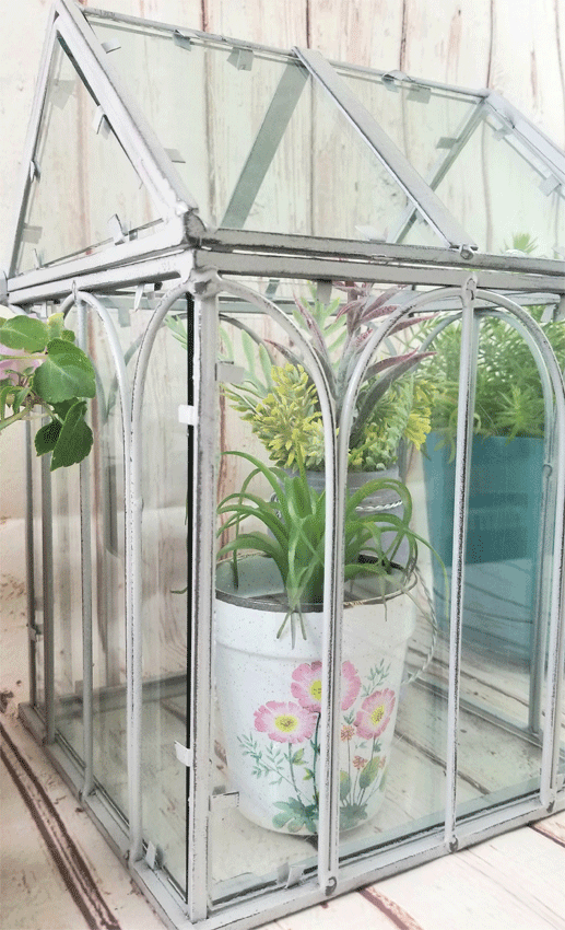 Finished mini greenhouse painted with chalk paint and distressed with sanding block