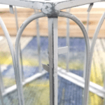 One of the corners of the greenhouse with the distressed sanded paint.