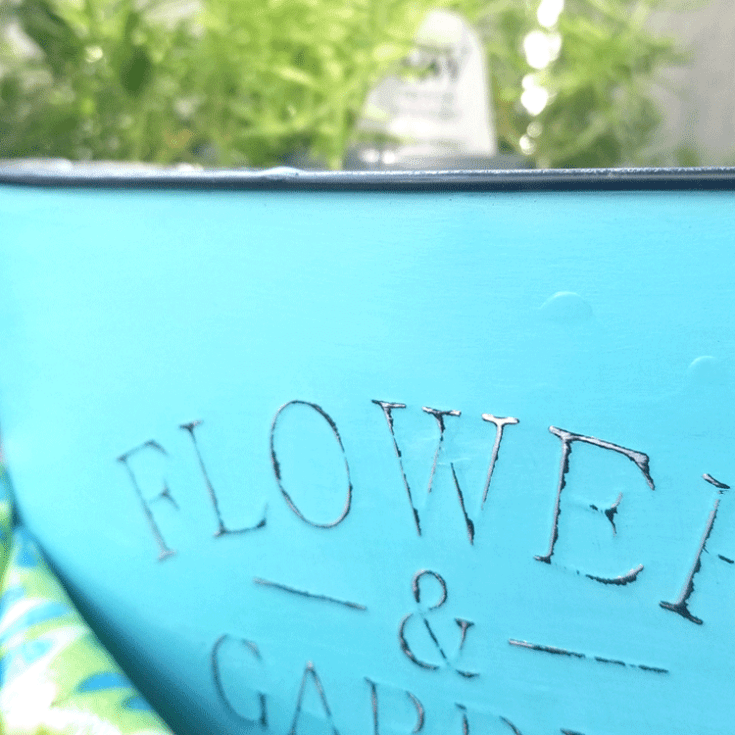 Close up of the finished distressed metal with chalk paint flower container