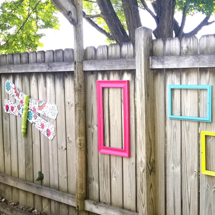 Dixie Belle transfers made this dragonfly fence decor shine with color.