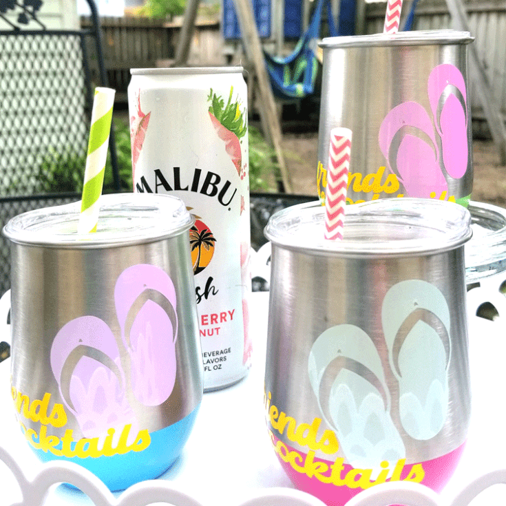 Finished metal wine glasses with colorful sun changing vinyl