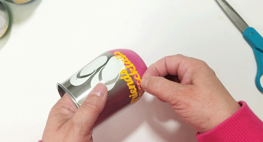 Adjusting some of the vinyl after it was placed onto the metal wine glass