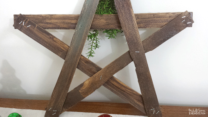 Back of wooden star showing the staples to hold it together.