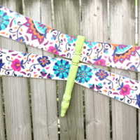 Finished dragonfly hanging on the fence