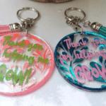 Finished DIY keychains using UV Resin and vinyl