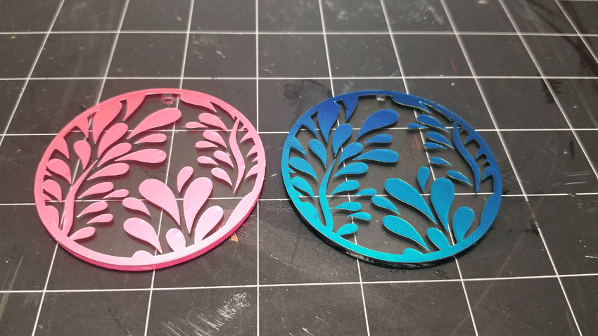 The background pieces weeded and applied to the acrylic keychain blanks.