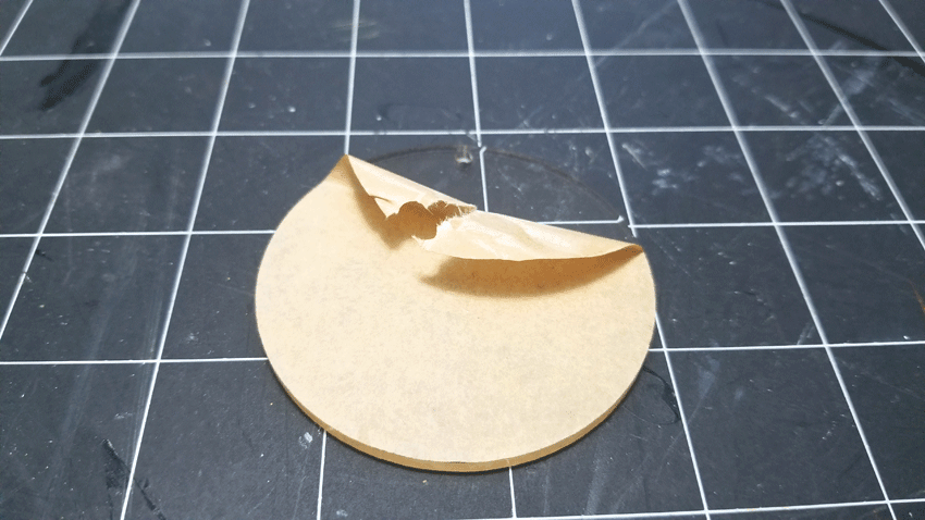 Removing the protective paper from bot side of the acrylic keychain blank