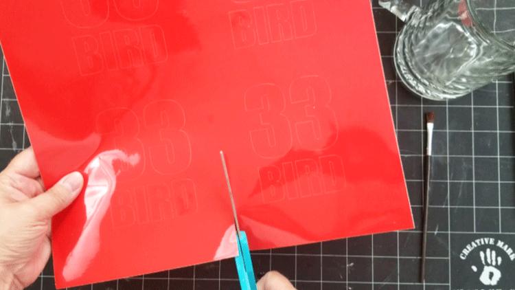 Cutting apart the four stencils.