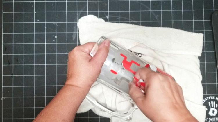 Peeling off the stencil after I finished rinsing the Etching cream
