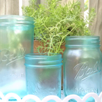 Finished tinted mason jars with stained glass spray paint.