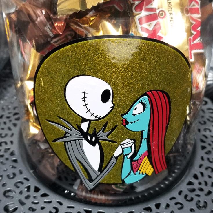Finished Halloween glass jar. Jack and Sally layered vinyl design.