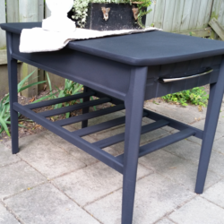 Sleek Black Table Makeover - www.michellejdesigns.com - I used Old Fashioned Milk Paint to transform this table into a sleek table for my son's apartment!